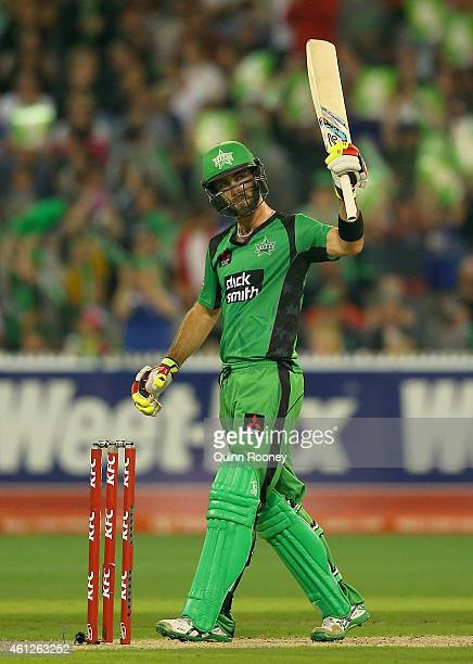 Glenn Maxwell of the Stars raises his bat after reaching 50 runs during the Big Bash League match between the Melbourne Stars and the Melbourne...