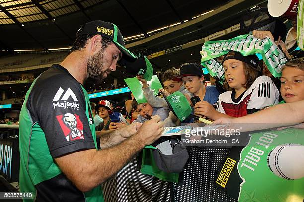 Glenn Maxwell of the Stars signs his autograph for fans following the Big Bash League match between the Melbourne Stars and the Hobart Hurricanes at...