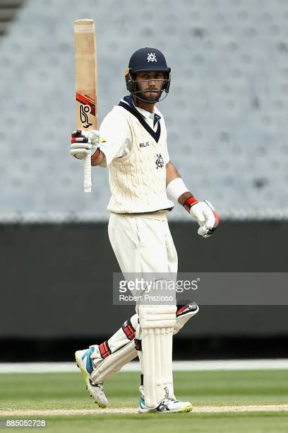 Glenn Maxwell of Victoria celebrates his half century during day two of the Sheffield Shield match between Victoria and Western Australia at...