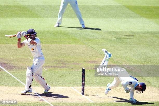 Glenn Maxwell of Victoria hits the ball past Peter Nevill of NSW during day two of the Sheffield Shield match between New South Wales and Victoria at...