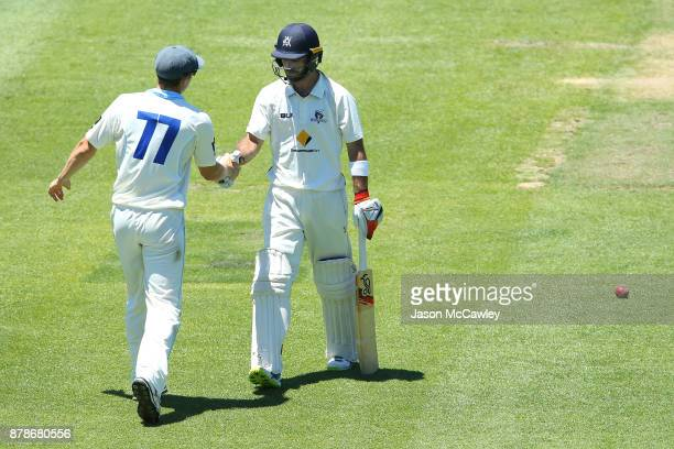 Glenn Maxwell of Victoria shakes hands with Sean Abbott of NSW after been dismissed by Stephen O'Keefe of NSW for 278 runs during day two of the...