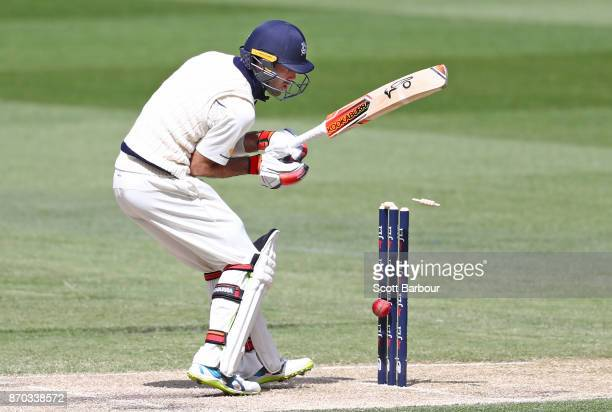 Glenn Maxwell of Victoria watches as the ball hits the stumps and he is dismissed during day two of the Sheffield Shield match between Victoria and...