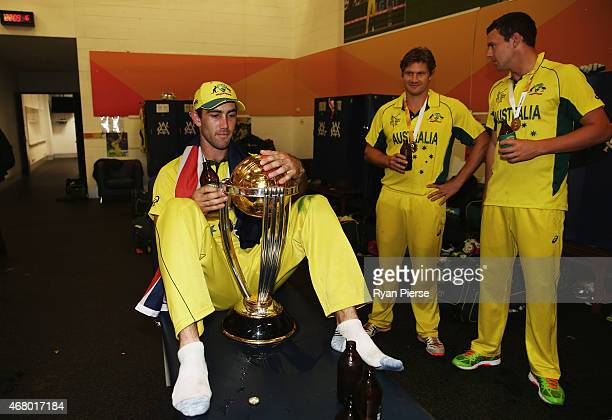 Glenn Maxwell Shane Watson and Josh Hazlewood of Australia celebrate with the trophy in the change rooms during the 2015 ICC Cricket World Cup final...