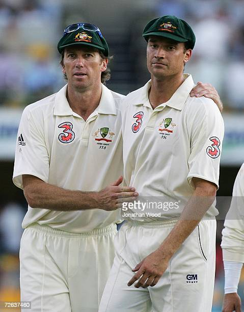 Glenn McGrath and Stuart Clark of Australia leavev the field at the end of play on day two of the first Ashes Test Match between Australia and...