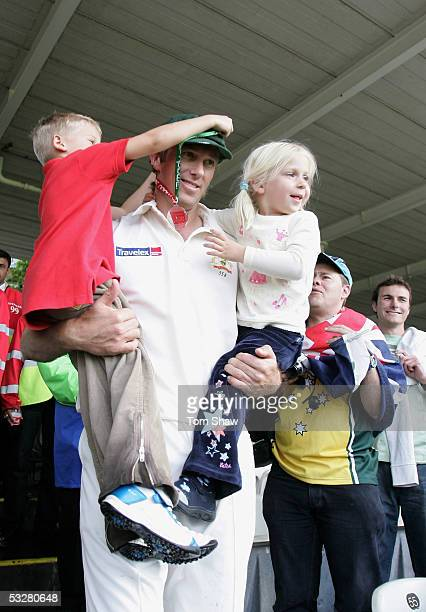 Glenn McGrath of Australia celebrates his man of the match award with his children Holly and James during day four of the first npower Ashes Test...
