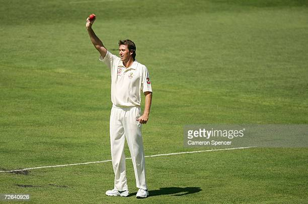 Glenn McGrath of Australia celebrates taking five wickets in England's first innings during day three of the first Ashes Test Match between Australia...