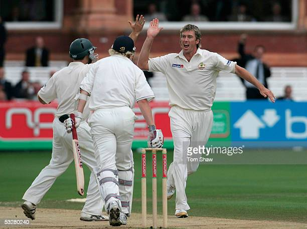 Glenn McGrath of Australia celebrates the wicket of Matthew Hoggard of England with Simon Katich during day four of the first npower Ashes Test match...