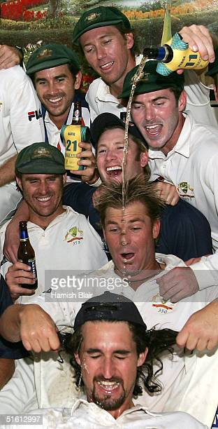 Glenn McGrath of Australia pours beer on teammate Jason Gillespie after day four of the Third Test between India and Australia played at the VCA...