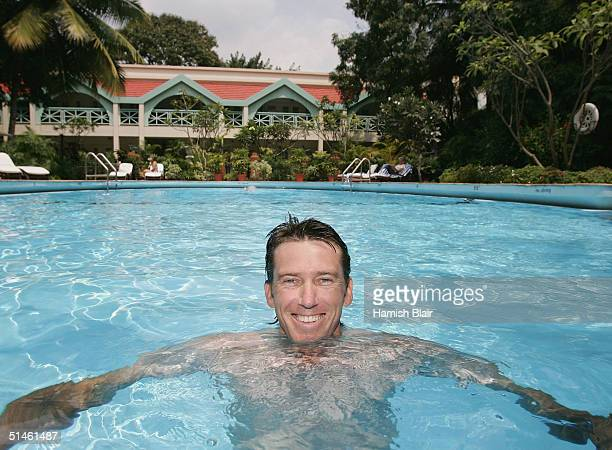 Glenn McGrath of Australia relaxes in the pool at the Taj West End Hotel on October 11 2004 in Bangalore India