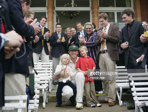 Glenn McGrath of Australia with children Holly and James is applauded by the members during day four of the First Test between England and Australia...