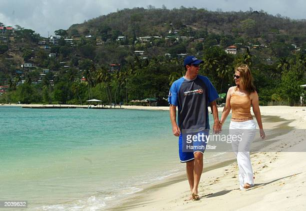 Glenn McGrath of Australia with wife Jane on May 29 2003 on the beach in St George's Grenada