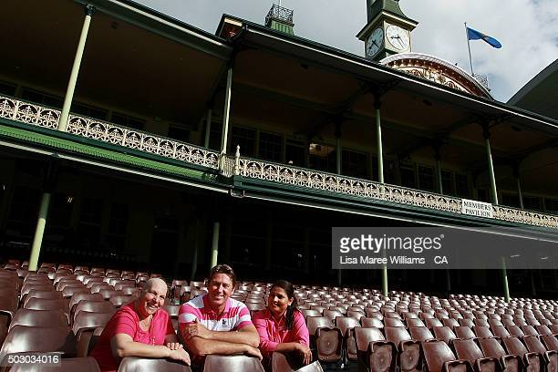 Glenn McGrath sits with Dina Wilson a cancer survivor and nurse Pharmila Saptoka during a Australian cricket team photo session at Sydney Cricket...