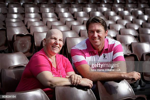Glenn McGrath sits with Dina Wilson a cancer survivor during a Australian cricket team photo session at Sydney Cricket Ground on January 1 2016 in...