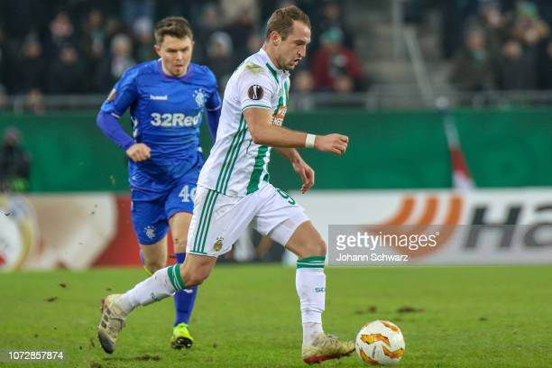 Glenn Middleton of Rangers and Veton Berisha of Rapid during the UEFA Europa League match between Rapid Wien and Rangers at Weststadion on December...