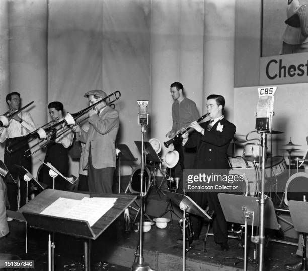 Glenn Miller and members of his orchestra perform with the Glenn Miller Orchestra for CBS radio at the Chesterfield Radio Playhouse in Times Square...