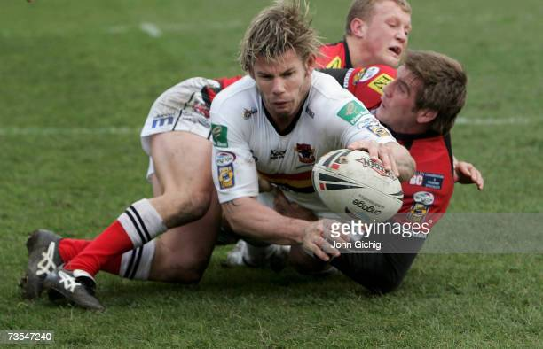 Glenn Morrison of the Bulls is tackled before the line during the engage Super League match between Bradford Bulls and Salford City Reds at The...
