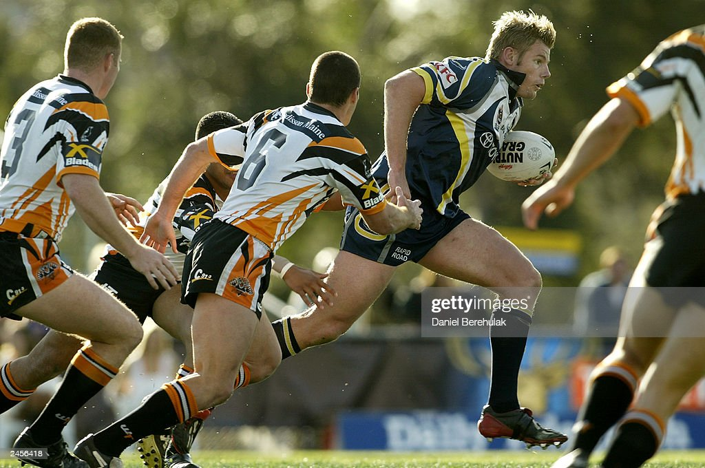 Glenn Morrison #13 of the Cowboys in action during the round 25 NRL match between the Wests Tigers and the North Queensland Cowboys at Campbelltown Oval August 31, 2003 in Sydney, Australia.