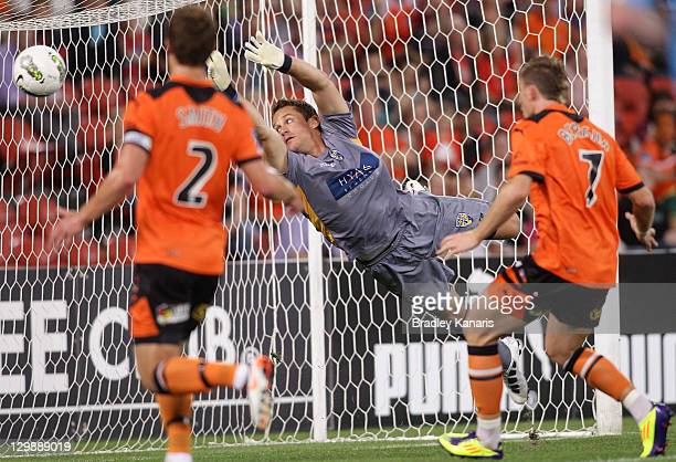 Glenn Moss of United dives as Erik Paartalu of the Roar celebrates scoring the goal during the round three ALeague match between the Brisbane Roar...