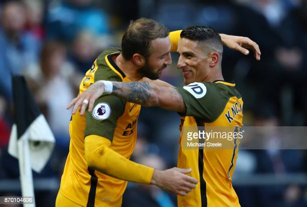 Glenn Murray celebrates scoring his side's first goal with Anthony Knockaert of Brighton and Hove Albion during the Premier League match between...