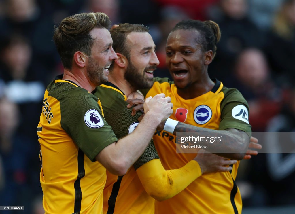 Glenn Murray celebrates scoring his side's first goal with Dale Stephens and Gaetan Bong of Brighton and Hove Albion during the Premier League match between Swansea City and Brighton and Hove Albion at Liberty Stadium on November 4, 2017 in Swansea, Wales.