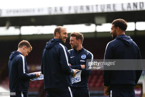 Glenn Murray Dale Stephens and Connor Goldson of Brighton and Hove Albion wlak on the pitch prior to the Premier League match between Burnley and...