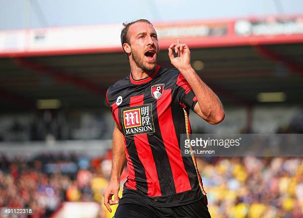 Glenn Murray of Bournemouth celebrates scoring his team's first goal during the Barclays Premier League match between AFC Bournemouth and Watford at...