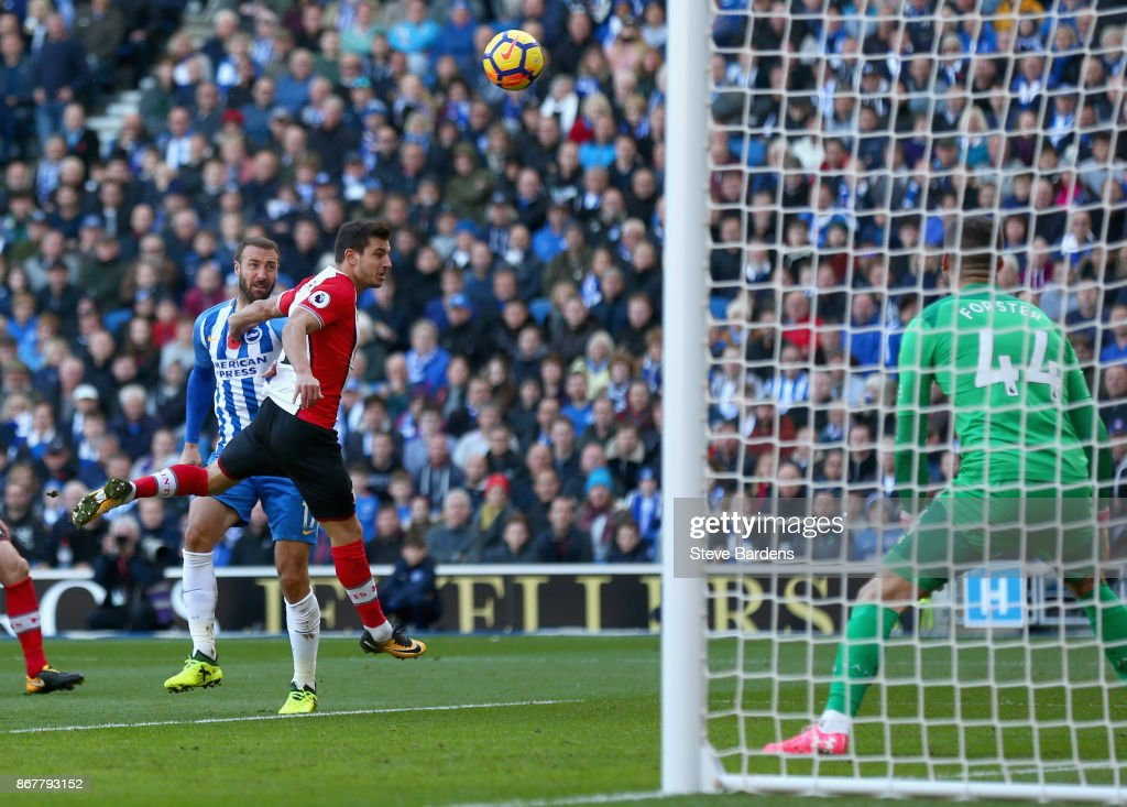 Glenn Murray of Brighton and Hove Albion (L) beats Cedric Soares of Southampton scores their first goal during the Premier League match between Brighton and Hove Albion and Southampton at Amex Stadium on October 29, 2017 in Brighton, England.