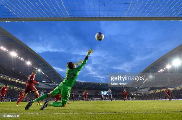 Glenn Murray of Brighton and Hove Albion beats Tomasz Kuszczak of Birmingham City to score his sides first goal during the Sky Bet Championship match...
