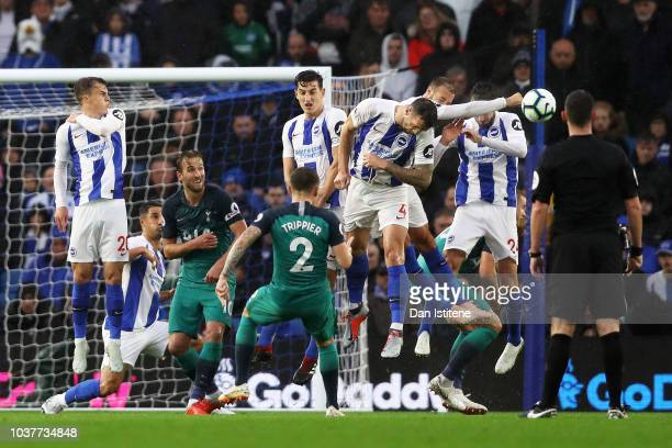 Glenn Murray of Brighton and Hove Albion blocks a free kick from Kieran Trippier of Tottenham Hotspur during the Premier League match between...
