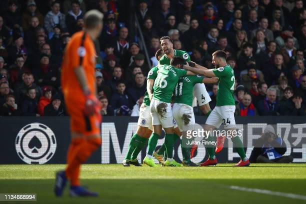 Glenn Murray of Brighton and Hove Albion celebrates after scoring his team's first goal with his team mates during the Premier League match between...