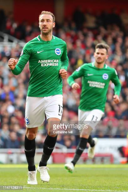 Glenn Murray of Brighton and Hove Albion celebrates after scoring his team's first goal from the penalty spot during the Premier League match between...