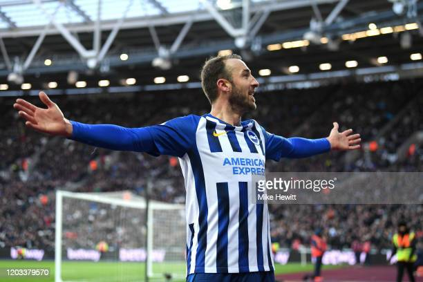 Glenn Murray of Brighton and Hove Albion celebrates after scoring his team's third goal during the Premier League match between West Ham United and...