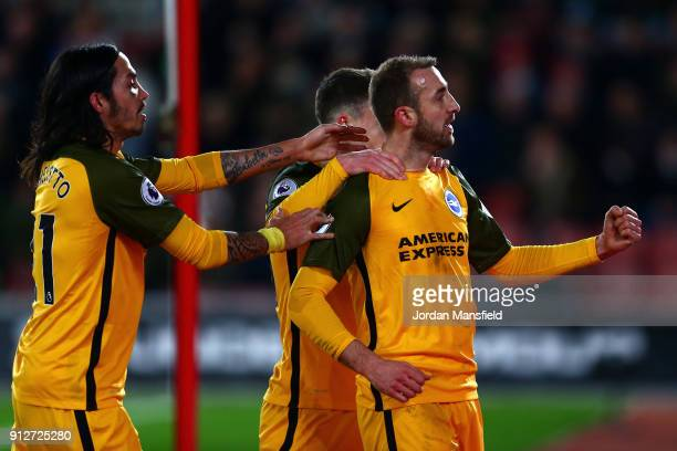 Glenn Murray of Brighton and Hove Albion celebrates after scoring his sides first goal during the Premier League match between Southampton and...
