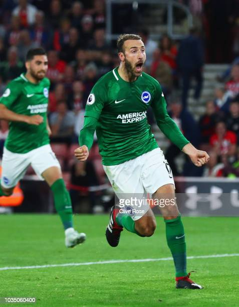 Glenn Murray of Brighton and Hove Albion celebrates as he scores his team's second goal from a penalty during the Premier League match between...