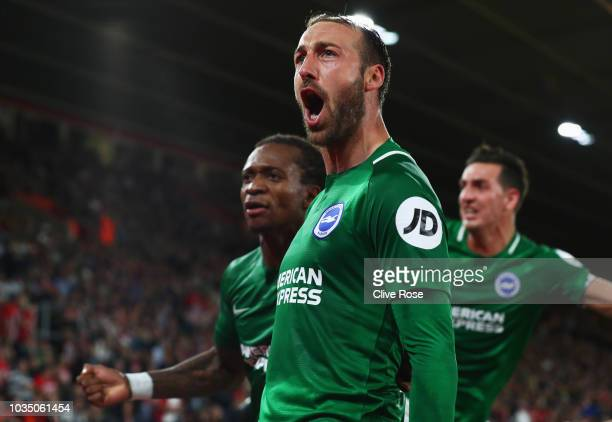 Glenn Murray of Brighton and Hove Albion celebrates as he scores his team's second goal from a penalty with team mates during the Premier League...