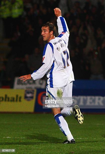 Glenn Murray of Brighton and Hove Albion celebrates as he scores their first goal during the Carling Cup Second Round match between Brighton and Hove...