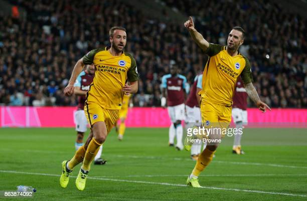 Glenn Murray of Brighton and Hove Albion celebrates as he scores their first goal with Shane Duffy during the Premier League match between West Ham...