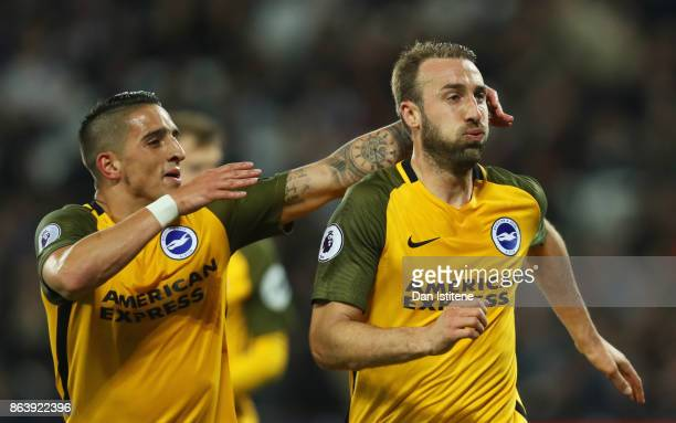 Glenn Murray of Brighton and Hove Albion celebrates as he scores their third goal from the penalty spot with team mate Anthony Knockaert during the...