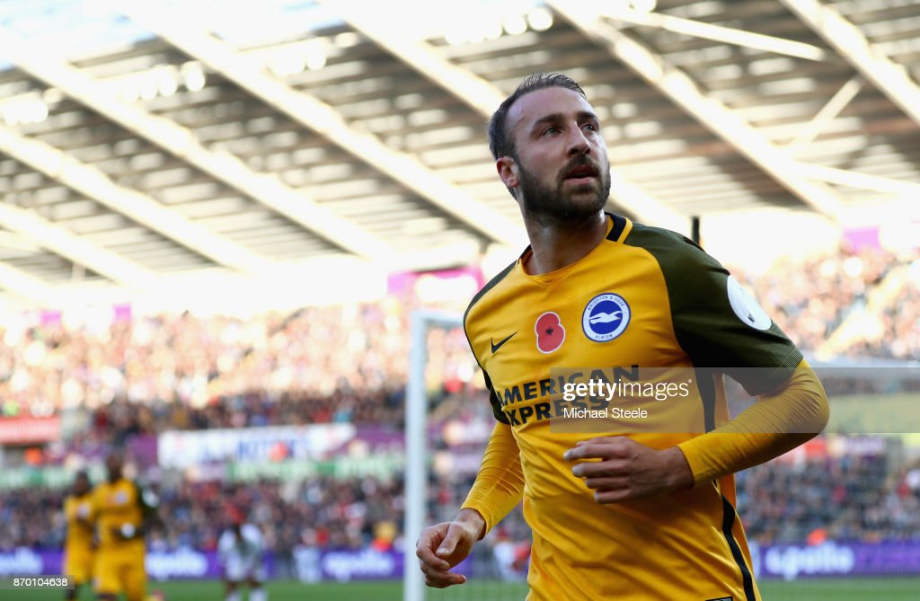 Glenn Murray of Brighton and Hove Albion celebrates scoring his side's first goal during the Premier League match between Swansea City and Brighton and Hove Albion at Liberty Stadium on November 4, 2017 in Swansea, Wales.