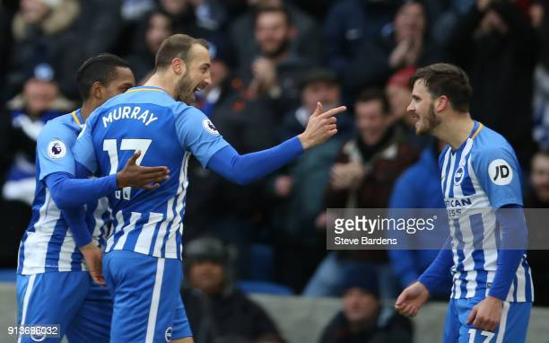 Glenn Murray of Brighton and Hove Albion celebrates scoring his side's first goal with team mates during the Premier League match between Brighton...
