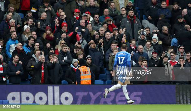 Glenn Murray of Brighton and Hove Albion celebrates scoring his sides second goal infront of the Arsenal supporters during the Premier League match...