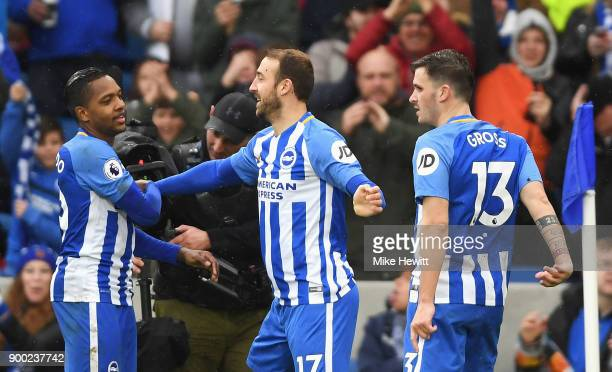 Glenn Murray of Brighton and Hove Albion celebrates scoring his team's second goal with Jose Izquierdo of Brighton and Hove Albion during the Premier...