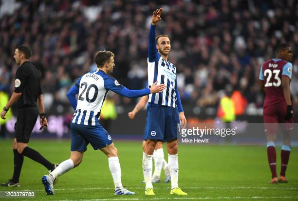 Glenn Murray of Brighton and Hove Albion celebrates with Solomon March after scoring his team's third goal during the Premier League match between...