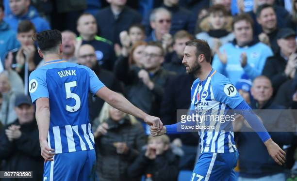 Glenn Murray of Brighton and Hove Albion celebrates with team mate Lewis Dunk of Brighton and Hove Albion as he scores their first goal during the...