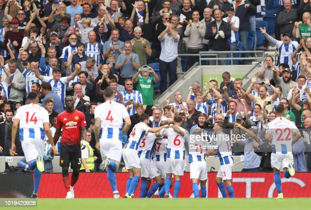 Glenn Murray of Brighton and Hove Albion celebrates with teammates after scoring his team's first goal during the Premier League match between...