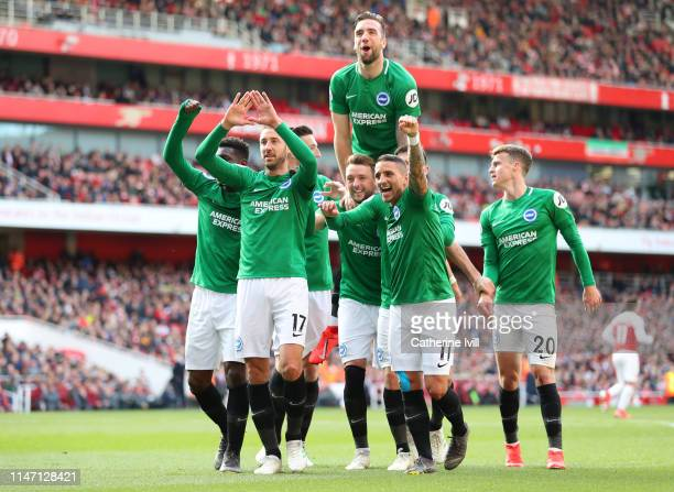 Glenn Murray of Brighton and Hove Albion celebrates with teammates after scoring his team's first goal from the penalty spot during the Premier...