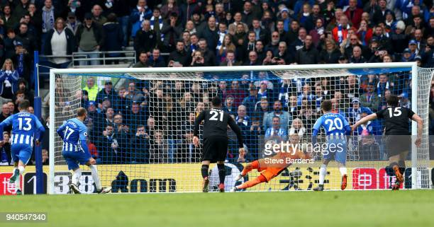 Glenn Murray of Brighton and Hove Albion has a penalty saved by Kasper Schmeichel of Leicester City during the Premier League match between Brighton...