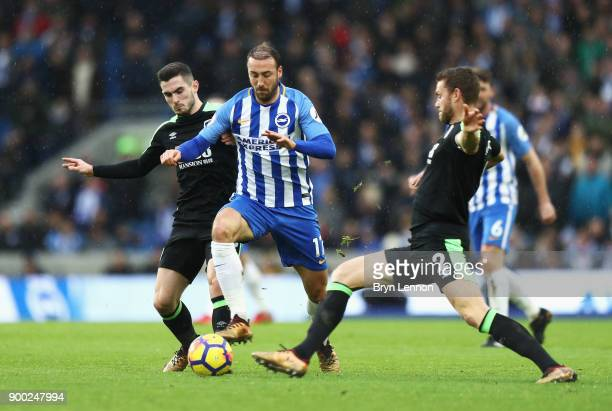 Glenn Murray of Brighton and Hove Albion is challenged by Simon Francis and Lewis Cook of AFC Bournemouth during the Premier League match between...