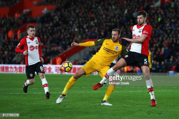 Glenn Murray of Brighton and Hove Albion is tackled by Jack Stephens of Southampton during the Premier League match between Southampton and Brighton...