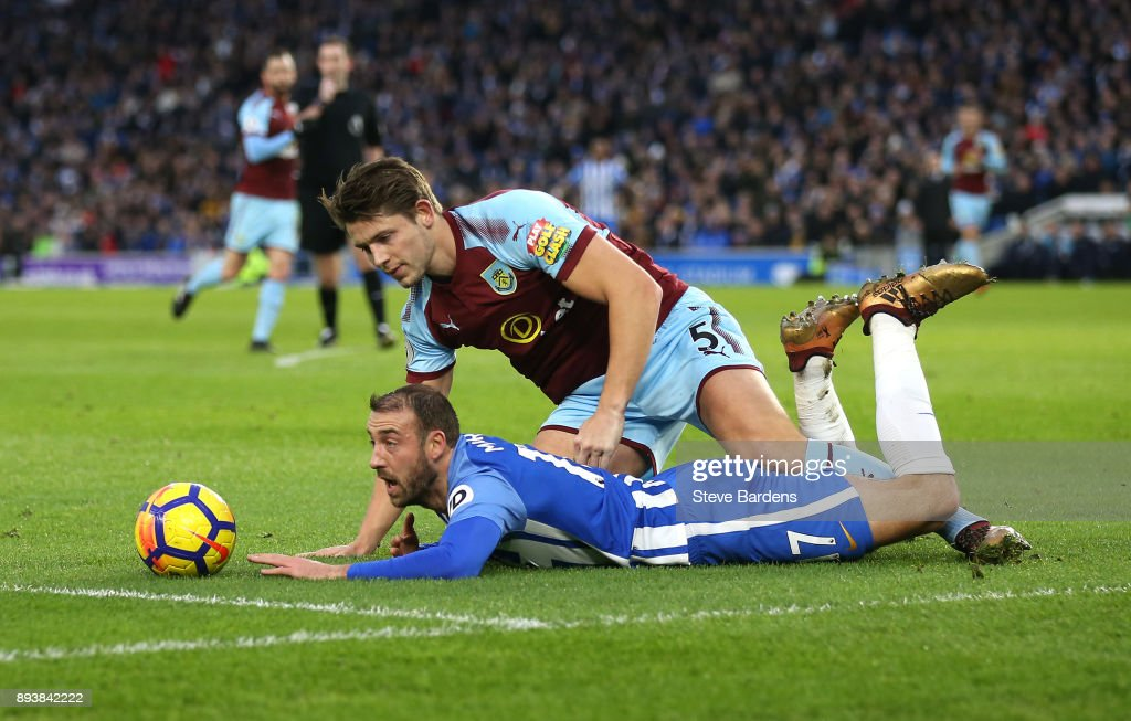 Glenn Murray of Brighton and Hove Albion is tackled by James Tarkowski of Burnley which leads to a penalty during the Premier League match between Brighton and Hove Albion and Burnley at Amex Stadium on December 16, 2017 in Brighton, England.